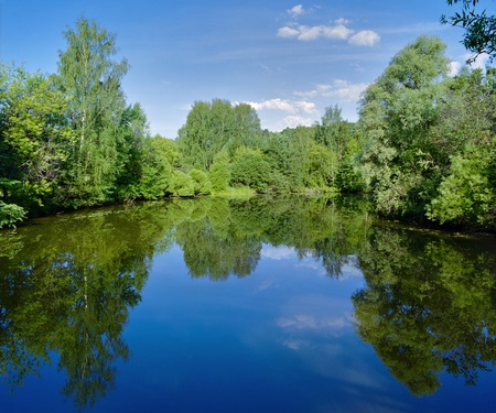 Landscape with trees, reflecting in the water Stock Photo - 11118094