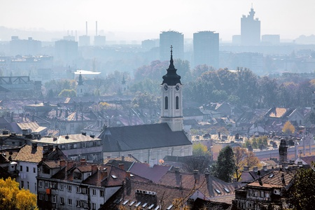 serbia: View of the Mother of God Nativity Church in Zemun and Belgrade in the haze, Serbia Stock Photo