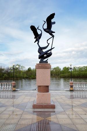 Sculpture of cranes on the Bira river embankment in Birobidzhan, Far East, Russia Stock Photo - 11500479