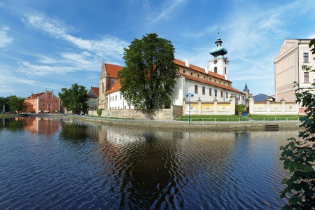 ceske: View from river to the Church of Presentation of Virgin Mary (backside) and Dominican Convent in Ceske Budejovice, Czech Republic
