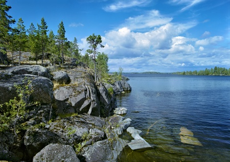 Stony shore of Ladoga lake, Karelia, Russia photo