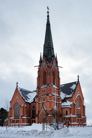 Umea City Church in winter overcast day, Sweden photo