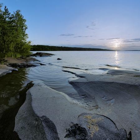 Sunset at stony shore of Ladoga lake, Karelia, Russia Stock Photo - 11964254