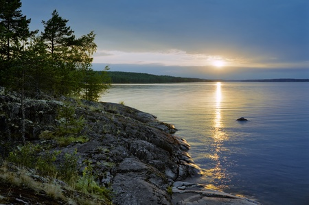 Sunset at stony shore of Ladoga lake, Karelia, Russia Stock Photo - 11964260