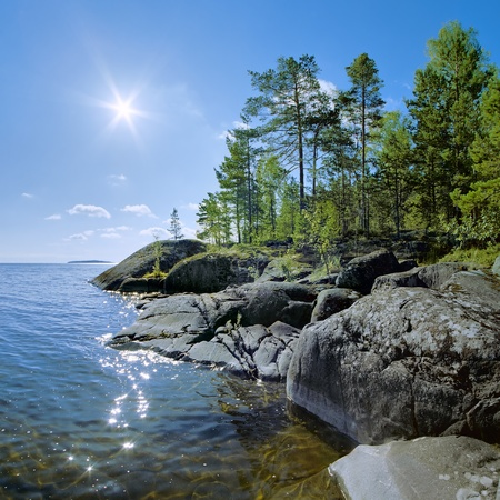 Sun and stony shore of Ladoga lake, Karelia, Russia photo