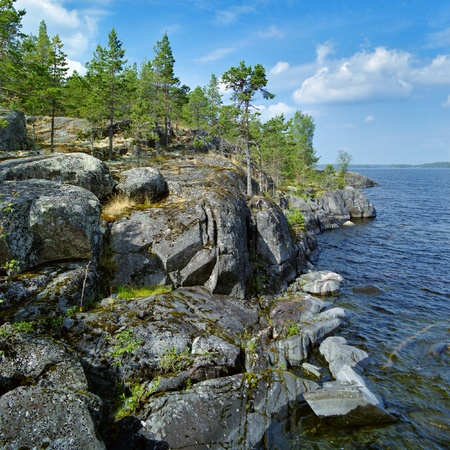 Stony shore of Ladoga lake, Karelia, Russia Stock Photo - 12010657