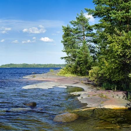 Stony shore of Ladoga lake, Karelia, Russia Stock Photo - 12056651