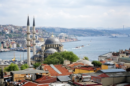 View of Yeni Mosque, Bosphorus and districts Eminonu and Beyoglu in Istanbul, Turkey photo