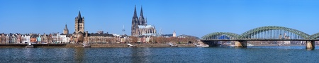 cologne: Large panorama of Cologne with Great St. Martin Church, Cologne Cathedral, Hohenzollern Bridge and the Rhine river, Germany