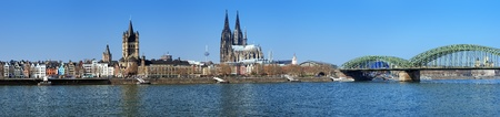 Large panorama of Cologne with Great St  Martin Church, Cologne Cathedral, Hohenzollern Bridge and the Rhine river, Germany Stock Photo
