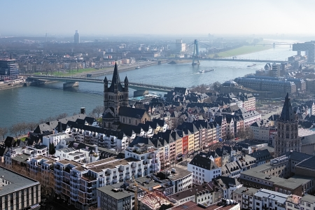View from Cologne Cathedral on Old Town , Great St Martin Church, Tower of Old City Hall and the Rhine river with bridges, Germany