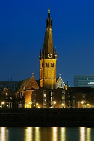 rhine westphalia: Dusseldorf, Evening view on Basilica of St  Lambertus from the Rhine river, Germany Stock Photo