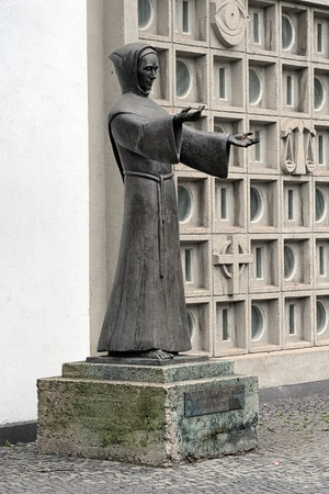 Statue of Francis of Assisi near the Franciscan Church of St  Anthony in Dusseldorf, Germany photo