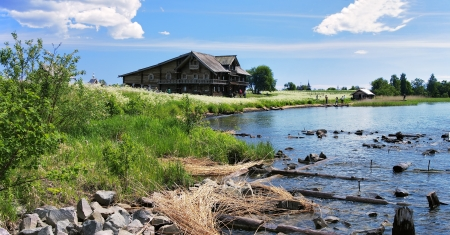 Wooden house on island Kizhi at the shore of lake Onega, Russia photo