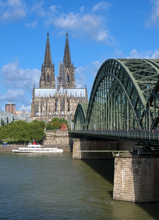 View on Cologne Cathedral and Hohenzollern Bridge over the Rhine river, Germany photo
