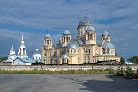 Nikolay Monastery in Verkhoturye with Cathedral of Exaltation of the Holy Cross in neo-byzantine style and Transfiguration church in classical style, Russia photo