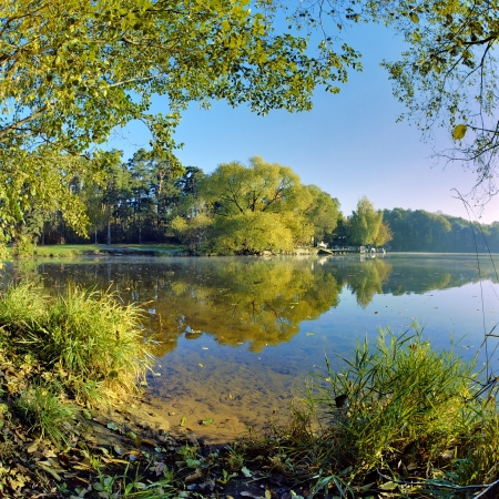 Wide angle landscape with trees reflecting in the lake in autumn, Russia Stock Photo - 16720010