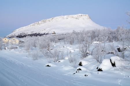 Saana mountain during the polar twilight in winter, Kilpisjarvi village, Finnish Lapland, Finland Stock Photo - 17410999