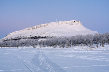 View of Saana Hill from Kilpisjarvi Lake in the polar twilight in winter, Finnish Lapland, Finland Stock Photo - 17411000