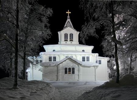 Gallivare church in winter night, Norrbotten County, Sweden photo