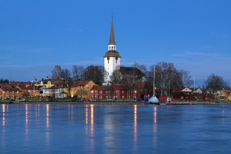 View of the Mariefred Town with Church from the Lake Malaren in winter evening, Sweden photo