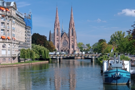 View on the St Paul Church from the Ill river in Strasbourg, France photo
