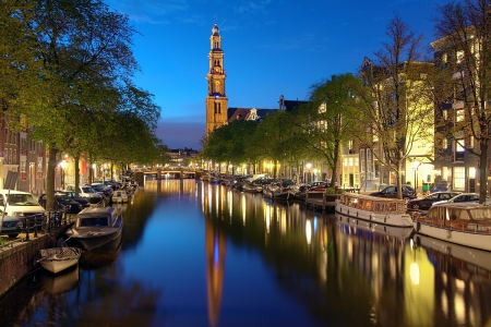 Evening view on the Westerkerk from Prinsengracht channel in Amsterdam, Netherlands photo