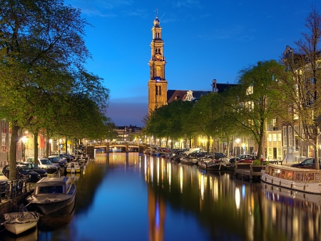 canal house: Evening view on the Westerkerk from Prinsengracht channel in Amsterdam, Netherlands