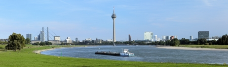 westfalen: Panorama of Dusseldorf with Rheinturm TV tower from the bend of Rhine river, Germany
