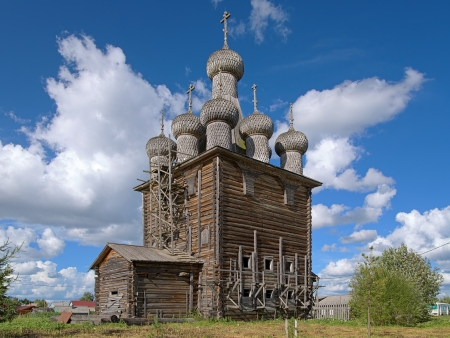 Wooden Church of Intercession of the Virgin Mary in the village Rikasovo near the Arkhangelsk, Russia photo