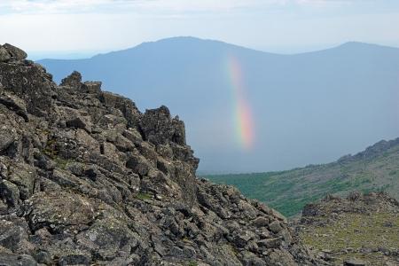 kazansky: Northern Ural Mountains, Rainbow on a background of Kazansky Rock Mount, view from the peak of Serebryansky Rock Mount, Russia