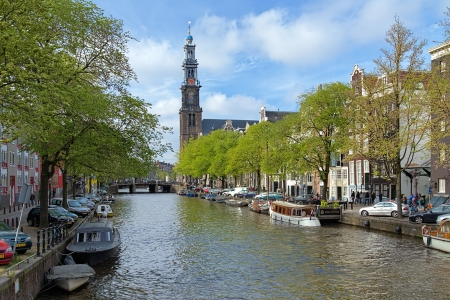 westerkerk: View of the Western church from Prinsengracht channel in Amsterdam, Netherlands