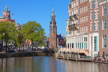 amstel: View of the Munttoren  Coin Tower  from Amstel River in Amsterdam, Netherlands Editorial