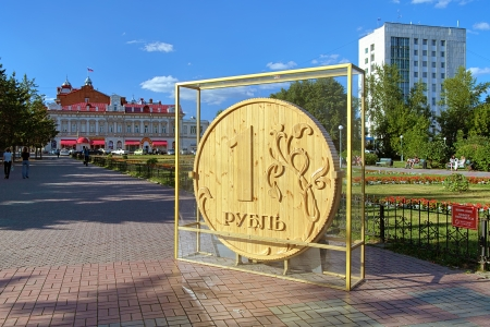 Wooden Ruble - monument in Tomsk, Siberia, Russia photo