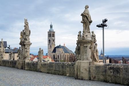 jesuit: Sculptures near the Jesuit College and view on the Church of St  James  kostel svateho Jakuba  in Kutna Hora, Czech Republic