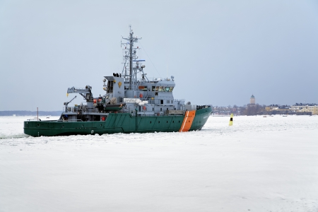 guard ship: Border guard ship and Suomenlinna fortress in the distance, Helsinki, Finland