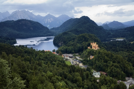 schwangau: View of the Bavarian Alps, village Schwangau and Hohenschwangau Castle, Germany