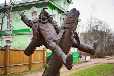 burbot: Monument to the peasant riding on burbot in Arkhangelsk, Russia Editorial