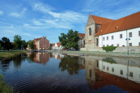 budejovice: River behind the Church of Presentation of Virgin Mary in Ceske Budejovice, Czech Republic