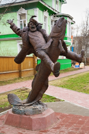 burbot: Monument to the peasant riding on burbot in Arkhangelsk, Russia Stock Photo