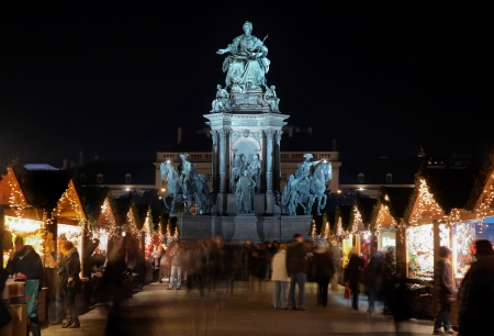 christkindlmarkt: Statue of Empress Marie-Theresa and Christmas Market in Maria-Theresien-Platz of Vienna, Austria