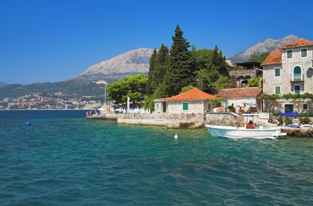 Houses on the coast of Kotor Bay, Montenegro photo