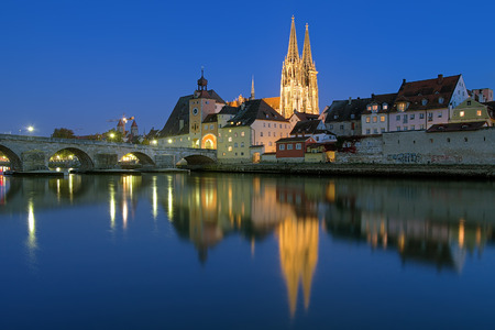 Evening view from Danube on Regensburg Cathedral and Stone Bridge in Regensburg, Germany