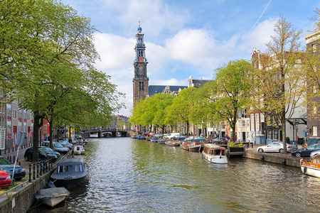protestant: View of Western church from Prinsengracht channel in Amsterdam, Netherlands Stock Photo