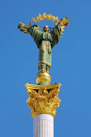 Statue of Berehynia on the top of Independence Monument on the Maidan Nezalezhnosti in Kiev, Ukraine photo