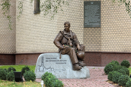 Monument of Firefighters - liquidators of consequences of the Chernobyl nuclear disaster, in Kiev, Ukraine photo