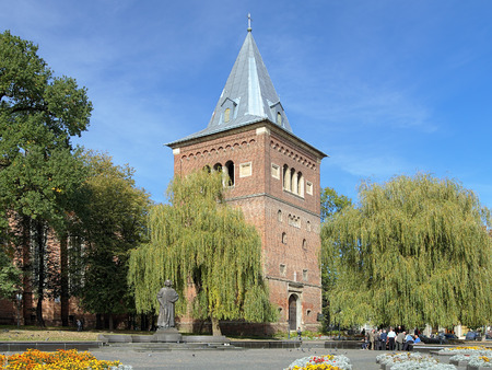 Bell tower of Church of St  Bartholomew and monument of Yuriy Drohobych in Drohobych, Lviv Oblast, Ukraine