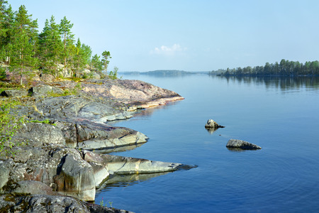 Stony shore of Ladoga lake in the morning, Karelia, Russia photo