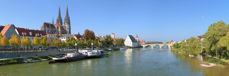 regensburg: Panoramic view on Danube river in Regensburg with Regensburg Cathedral, Tower of Town Hall, Salt House and Stone Bridge, Germany Stock Photo