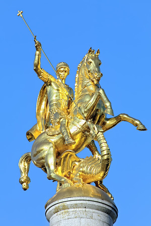 Sculpture of St George slaying the dragon on the top of Freedom Monument on Freedom Square in Tbilisi, Georgia